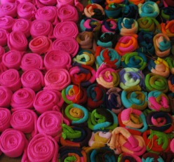 Knit tubes, wound up like psychedelic cinnamon buns